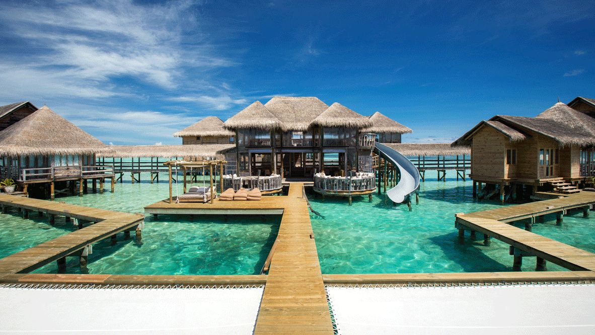Hotels in heaven gili lankanfushi maldives accommodation bungalow slide wooden path terrace bed cushions