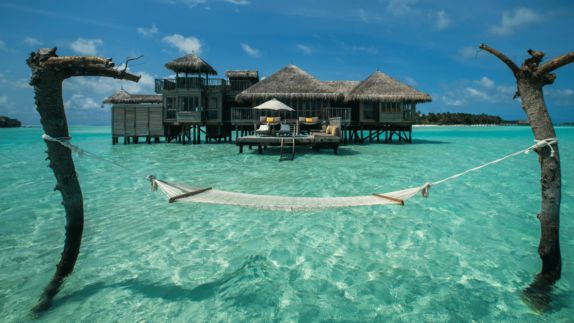 Hotels in heaven gili lankanfushi maldives hammock ocean trees water wooden shacks island houses side view