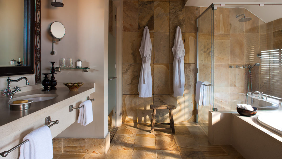 hotels in heaven four seasons safari lodge serengeti spa bathroom white bathrobes sink mirror shower bathtub soap