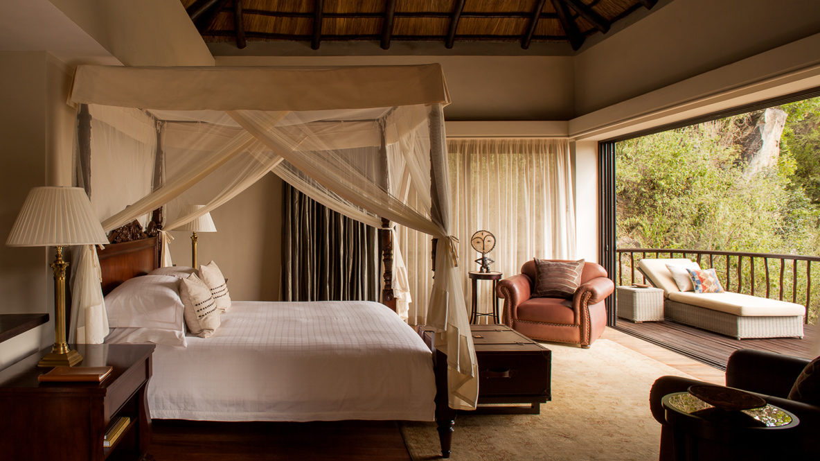 hotels in heaven four seasons safari lodge serengeti room bedroom big bed white linen canopy balcony lounger carpet wooden floor
