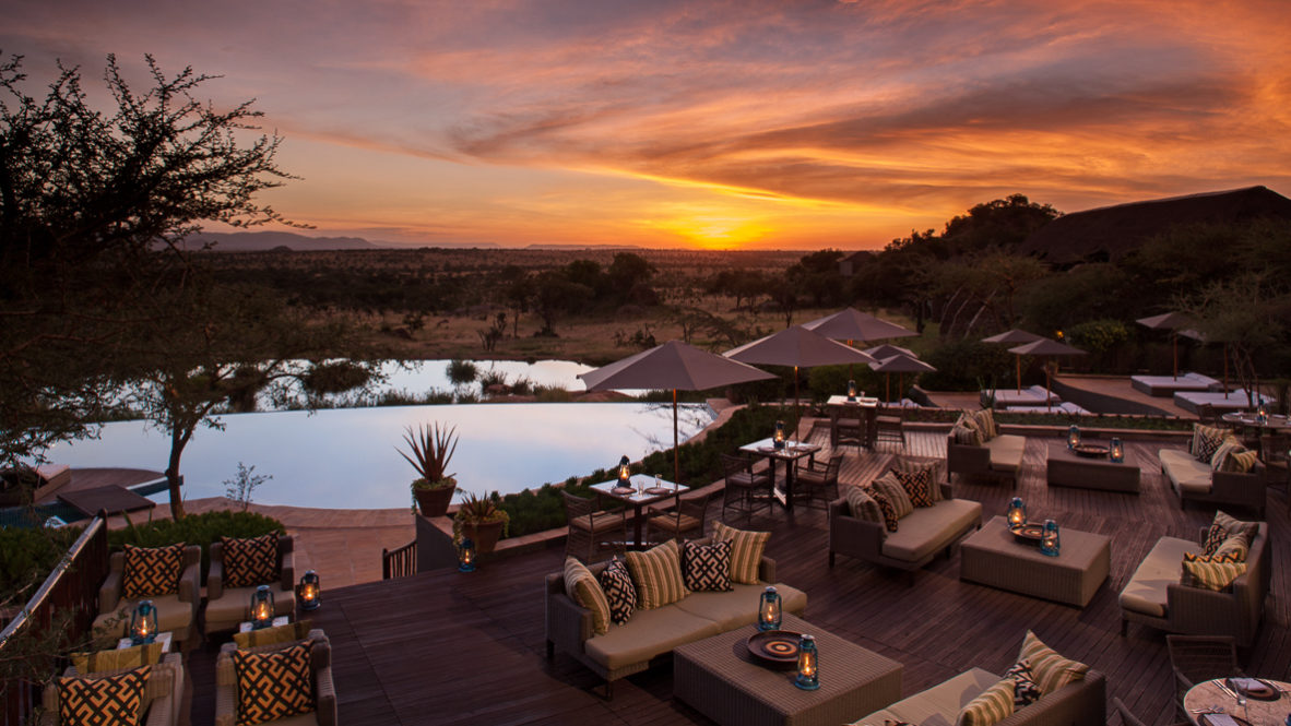 hotels in heaven four seasons safari serengeti terrace sofa cluster sun shades cushions lamps pools trees table chairs view