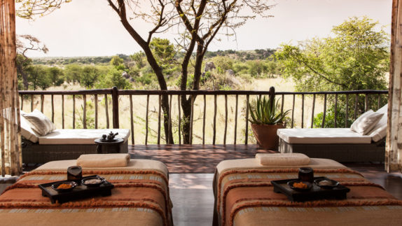 hotels in heaven four seasons safari lodge serengeti location spa relaxing wildlife lounger view savannah trees