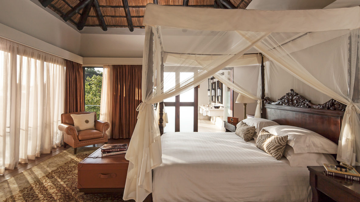 hotels in heaven four seasons safari lodge serengeti room bedroom bed canopy wooden carving armchair leather