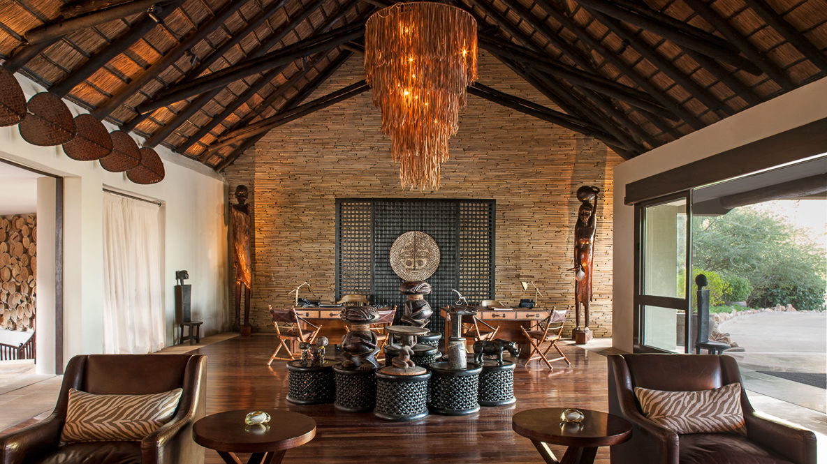 hotels in heaven four seasons safari lodge serengeti location statues figures typical art armchairs wooden floor chandelier