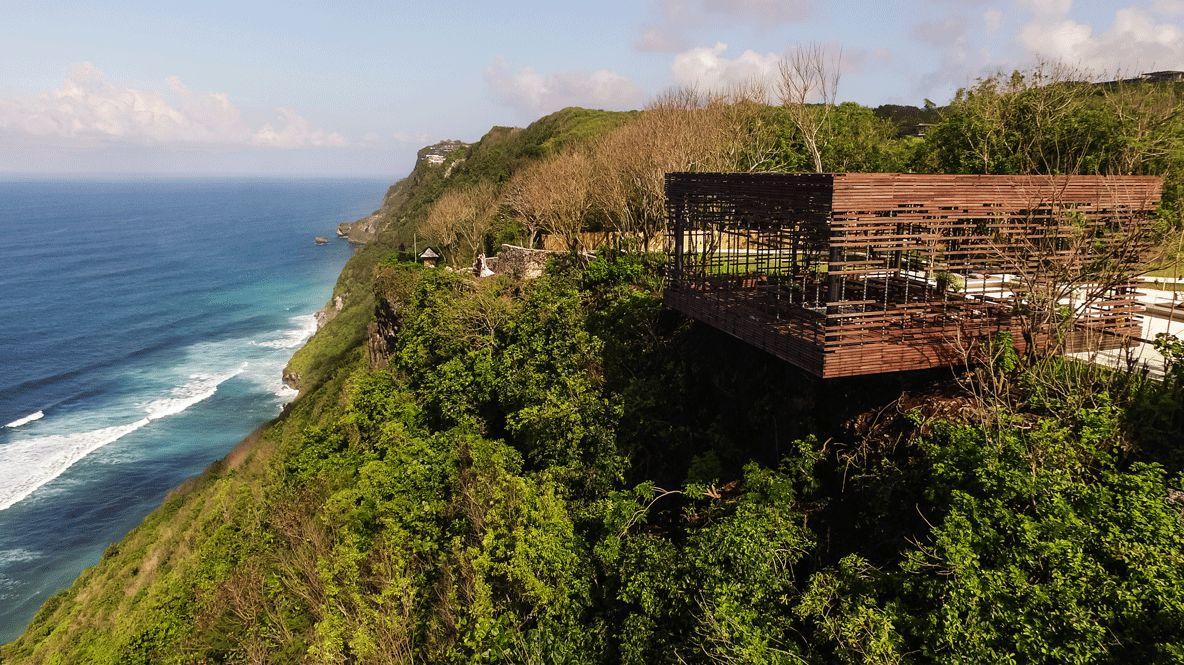hotels in heaven alila villas uluwatu location wooden cave cliff ocean bushes grass green waves shore