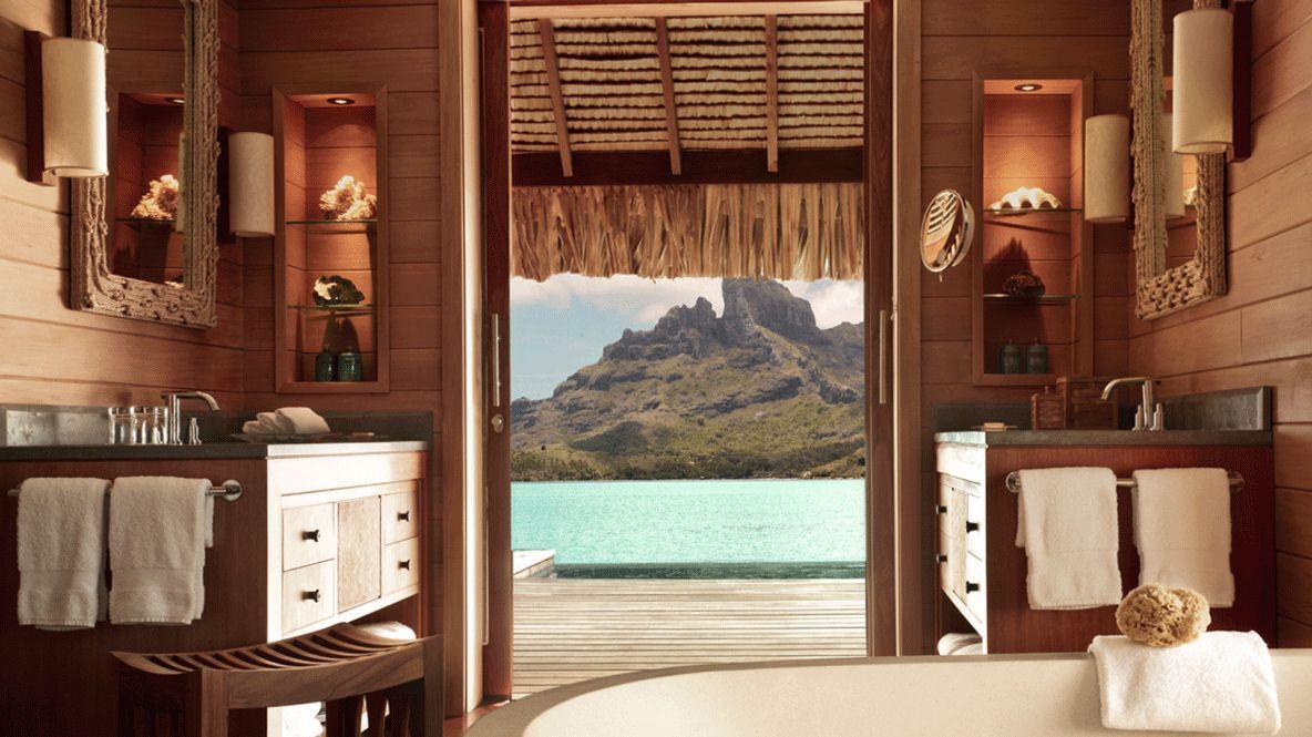 hotels in heaven four seasons bora bora room tub view mountains ocean bath sink wooden terrace mirror lamps