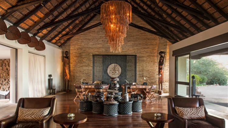 hotels in heaven four seasons safari lodge serengeti location statues figures typical art armchairs wooden floor chandelier