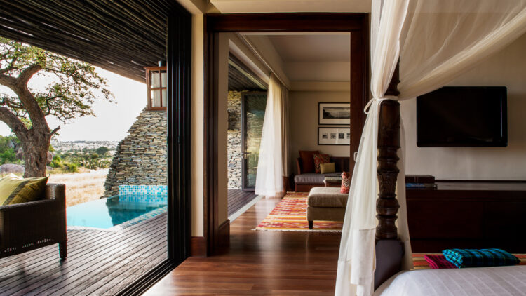 hotels in heaven four seasons safari lodge serengeti room bed small pool view canopy armchair lamps wild life