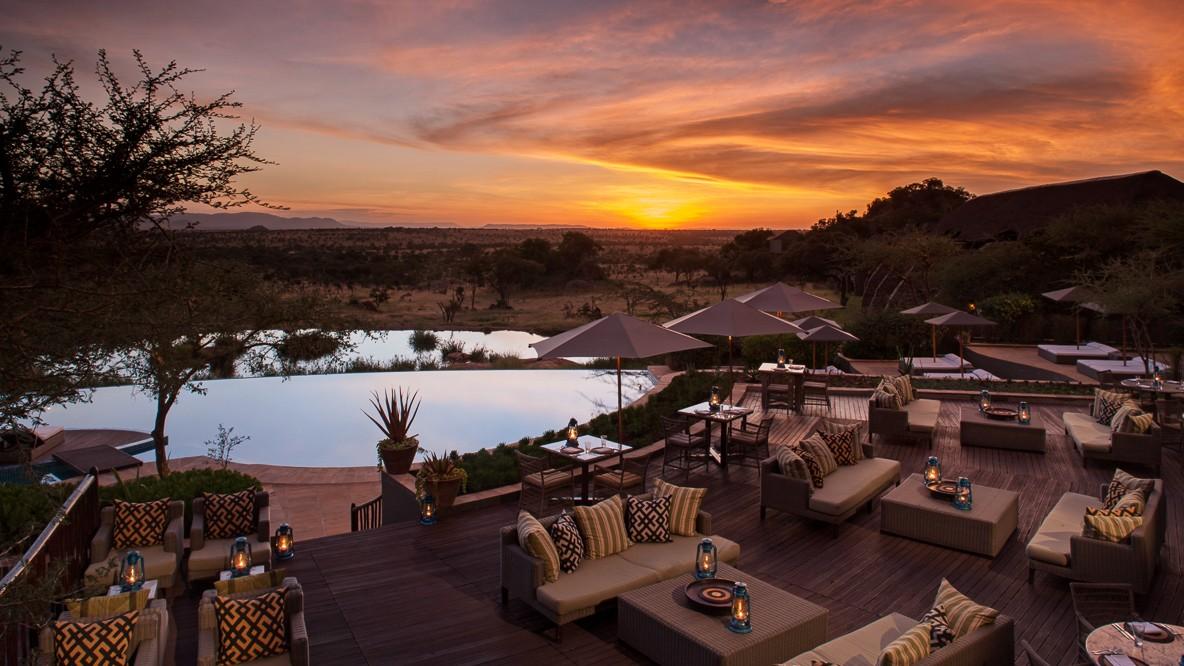 hotels in heaven four seasons safari serengeti terrace sofa cluster sun shades cushions lamps pools trees table chairs view