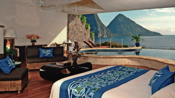 hotels in heaven Jade Mountain room bed great view ocean wooden table plants lounger armchair white wall black desk