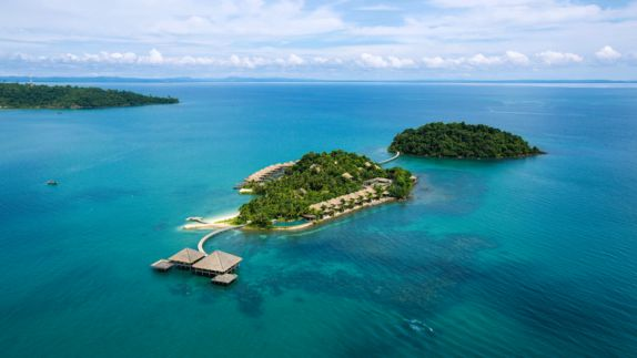 hotels in heaven Song Saa Private Island Ariel surrounded by water blue trees hill cloudy sky wide ocean