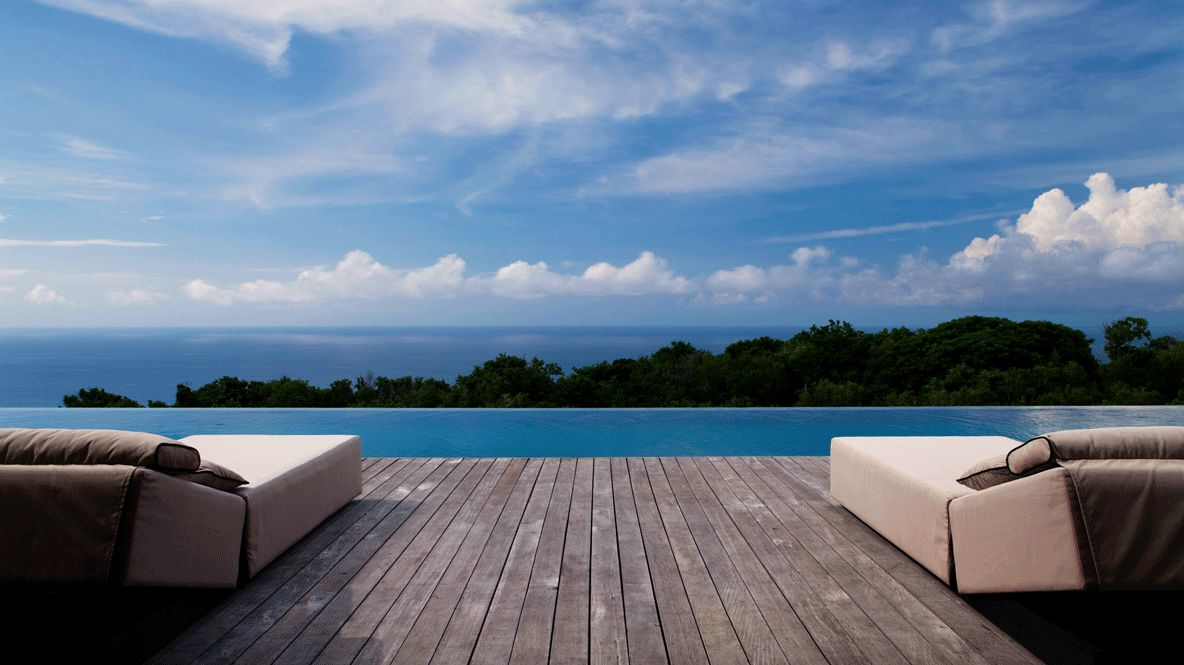 hotels in heaven alila villas uluwatu pool view terasse sky pool wooden floor trees clouds pillows spa panorama