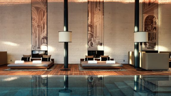 hotels in heaven chedi andermatt CAM Pool Lounges pool water lamp spa lounger stairs artwork black columns