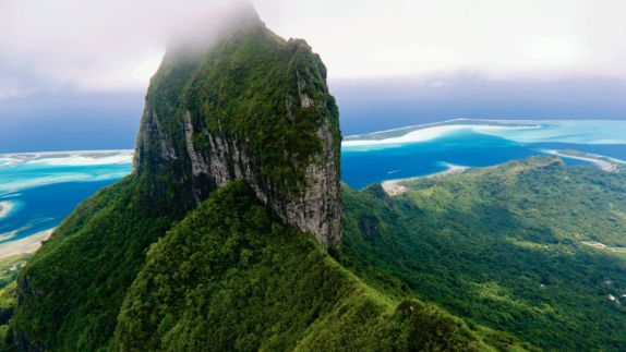hotels in heaven four seasons bora bora location mountain birdeye view top foggy clouds ocean trees green landscape