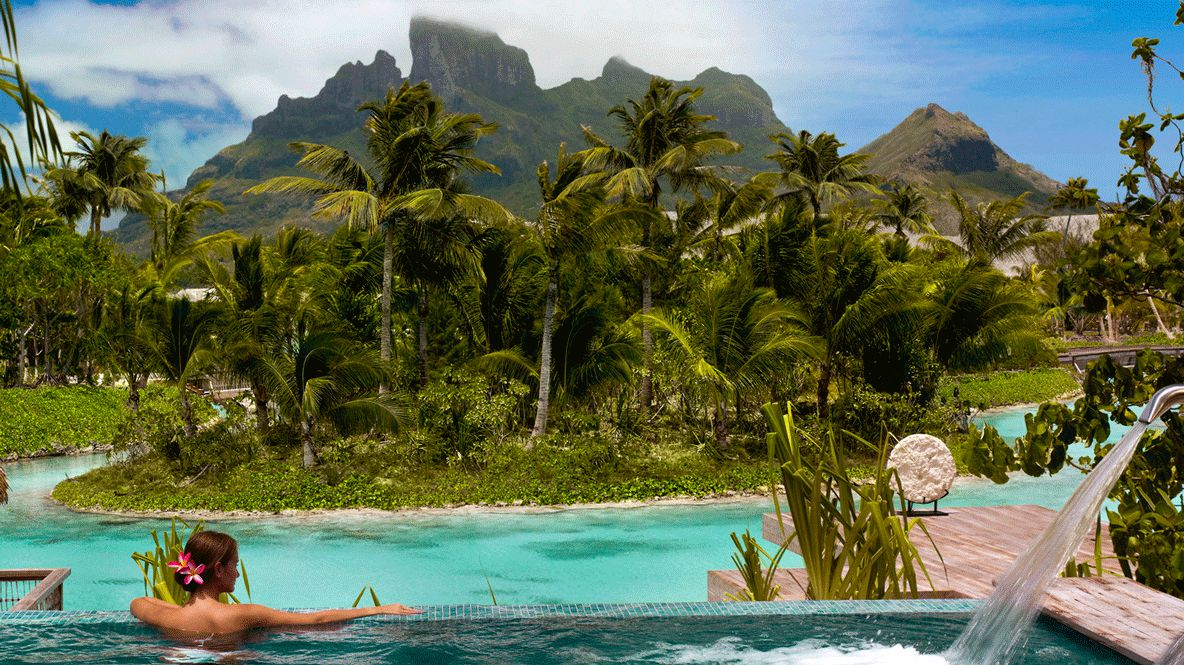 hotels in heaven four seasons bora bora spa pool view rainforest palm trees relaxing area water woman mountains grass