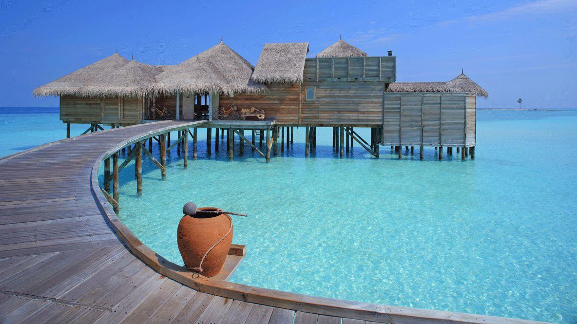 hotels in heaven gili lankanfushi maldives bridge accommodation pottery vase curvy path bungalow wooden sky