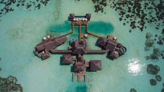 hotels in heaven gili lankanfushi maldives drone reef ocean shacks island sun reflection boat bridge top view