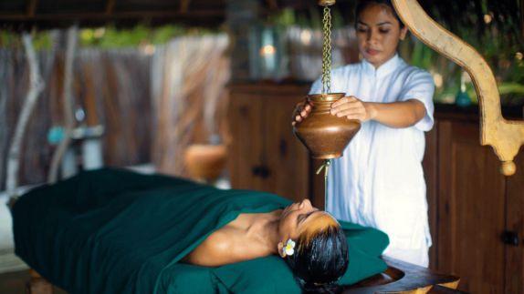 hotels in heaven gili lankanfushi maldives spa treatment woman white robes relaxing green blanket