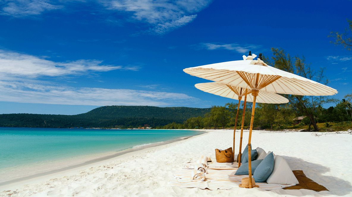 hotels in heaven song saa beach pillows sand ocean water blue trees sky sunny shades blankets bag forest hill