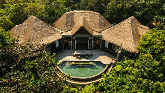 hotels in heaven song saa house forest round pool turquoise three shacks wooden floor trees terrace table