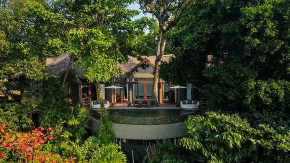 hotels in heaven song saa overview hidden secretive place trees green leaves pool side windows terrace