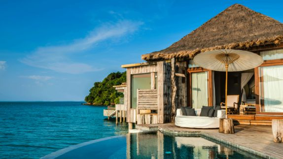 hotels in heaven song saa overwater villa interior private island sea water ocean pool sunny shades wooden shack