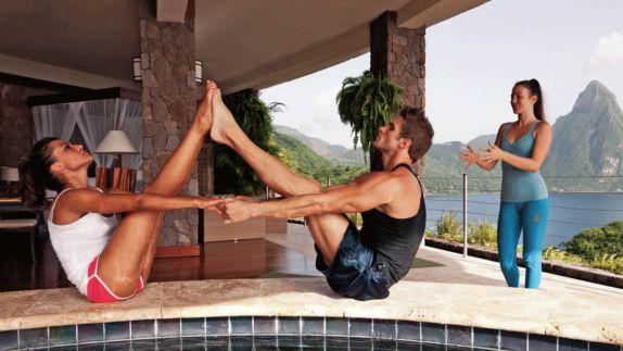 hotels in heaven Jade Mountain activities yoga man woman instructor ocean mountain view poolside stone floor