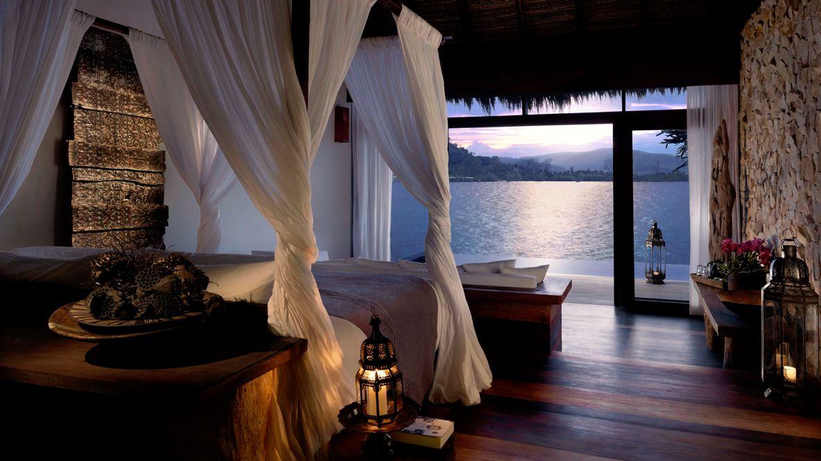 hotels in heaven song saa private island one bedroom over water villa interior view bed wooden floor ocean