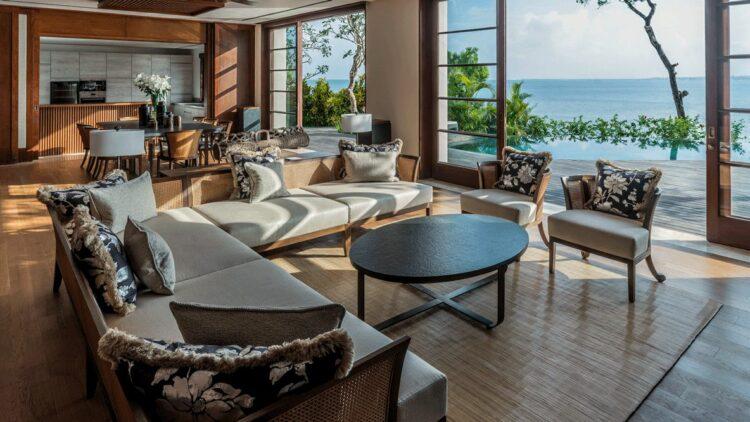 hotels in heaven four seasons bali room view balkony sea couch armchair wood floor