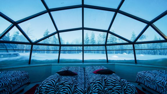 hotels in heaven Kakslauttanen glass igloo view sky trees snowy tips snow bed pillows grid beautiful small romantic