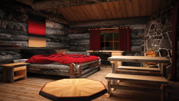 hotels in heaven Kakslauttaunen Kelo Glass Igloo inside bed red blanket wooden floor walls ceiling table fire place