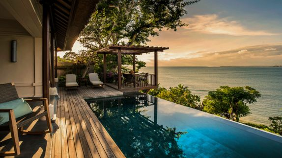 hotels in heaven four seasons resort bali oceanview terasse outdoor pool sunset sky sea tree pool mountain tree colorful