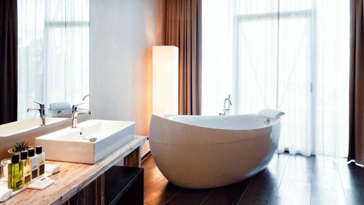 hotels in heaven alpina dolomites bathroom bathtub clean white ceramic sink bodywash soaps window curtains