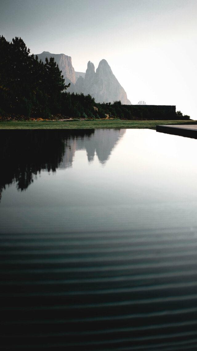 lake hotel-alpina dolomites lodge italy