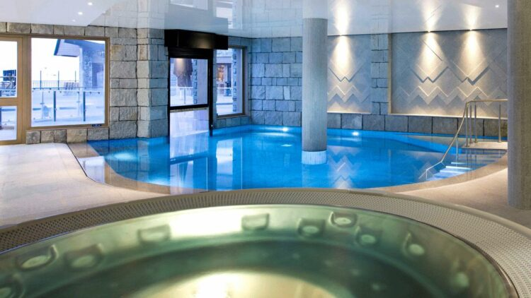 hotels in heaven altapura val thores indoor pool spa water blue columns loungers lifebelt ceramic tiles