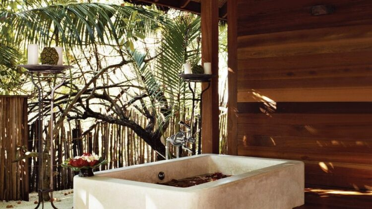 hotels in heaven como cocoa island spa mud bath bathtub wooden wall palm trees candles tab beautiful sunny