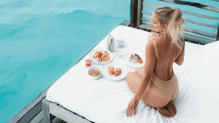 hotels in heaven como cocoa island culinary influencer new blonde bathing suit breakfast food water terrace view