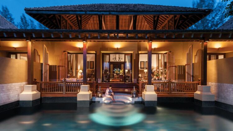 hotels in heaven four seasons langkawi pool outdoor woman relaxing water nighttime lights house terrace