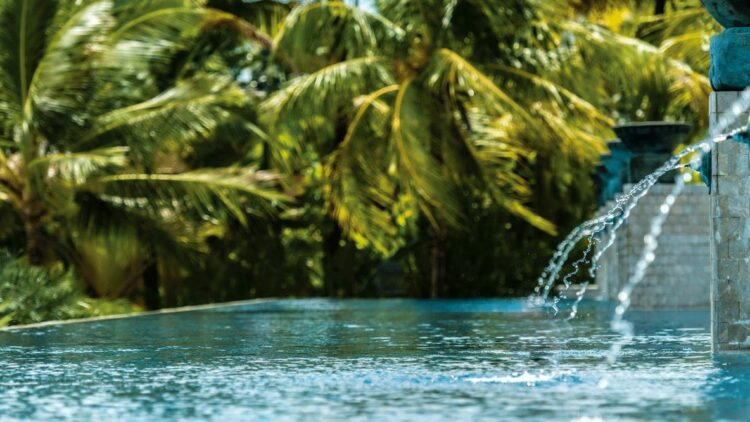 hotels in heaven four seasons langkawi pool spa outside water fountain palm trees beautiful mirror stone wall