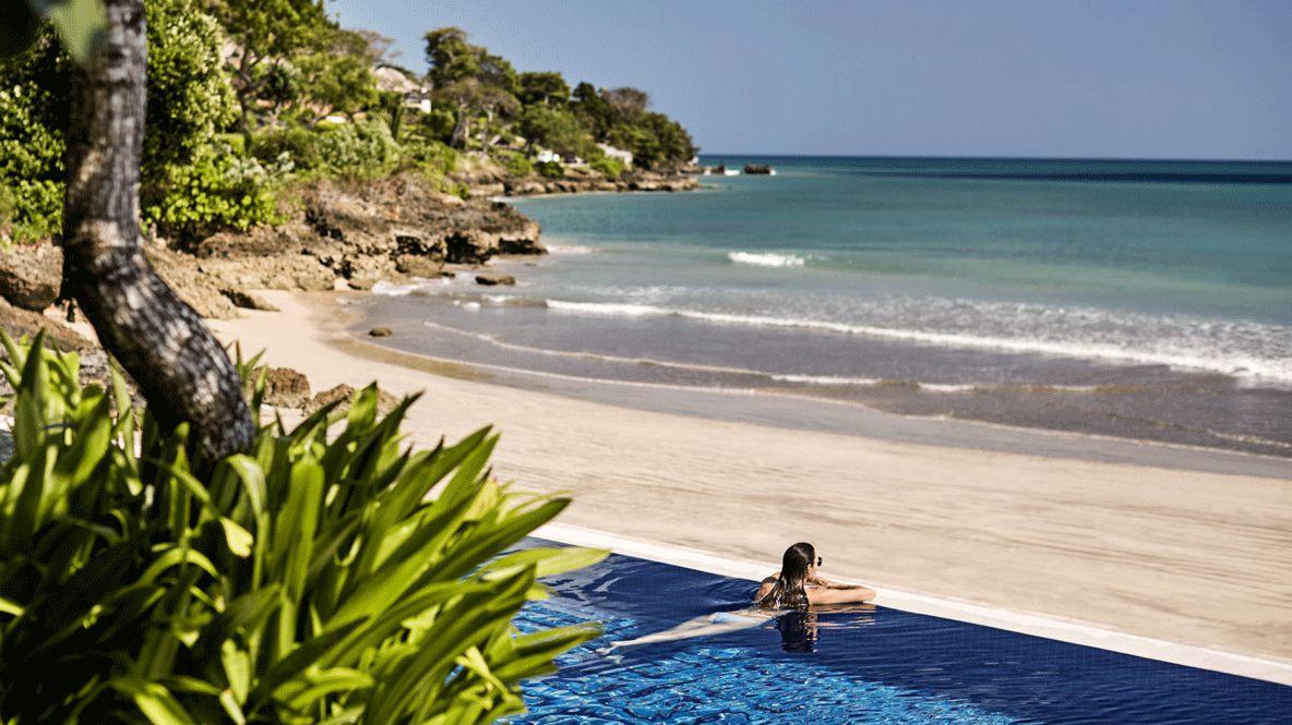 hotels in heaven four seasons resort bali pool beach view sea plants trees sky sun rock