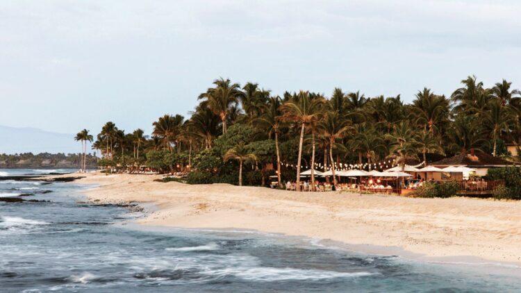 hotels in heaven four seasons hualalai outdoor beach ocean waves water blue people tables dinner