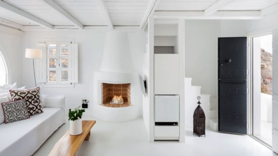 hotels in heaven aenaon villas indoor room all white stove modern stairs couch window