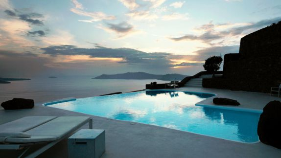 hotels in heaven aenaon villas pool outdoor view sea mountains deckchair sunset