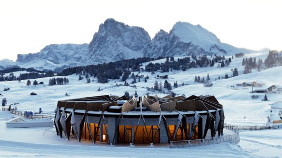 hotels in heaven alpina dolomites outdoor location rounded house room lights snowy mountains view winter architecture icy trees
