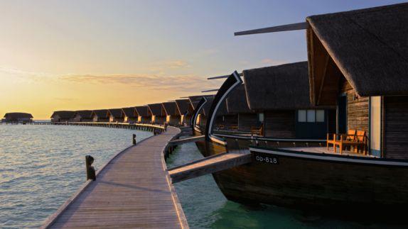 hotels in heaven como cocoa island accommodation ocean view little boat shacks docks wooden path bridge water