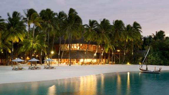 hotels in heaven conrad maldives rangali location accommodation beach sand palm trees lights house loungers sun shades