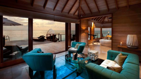 hotels in heaven conrad maldives rangali villa luxury living room blue sofas cushions ocean view loungers telescope