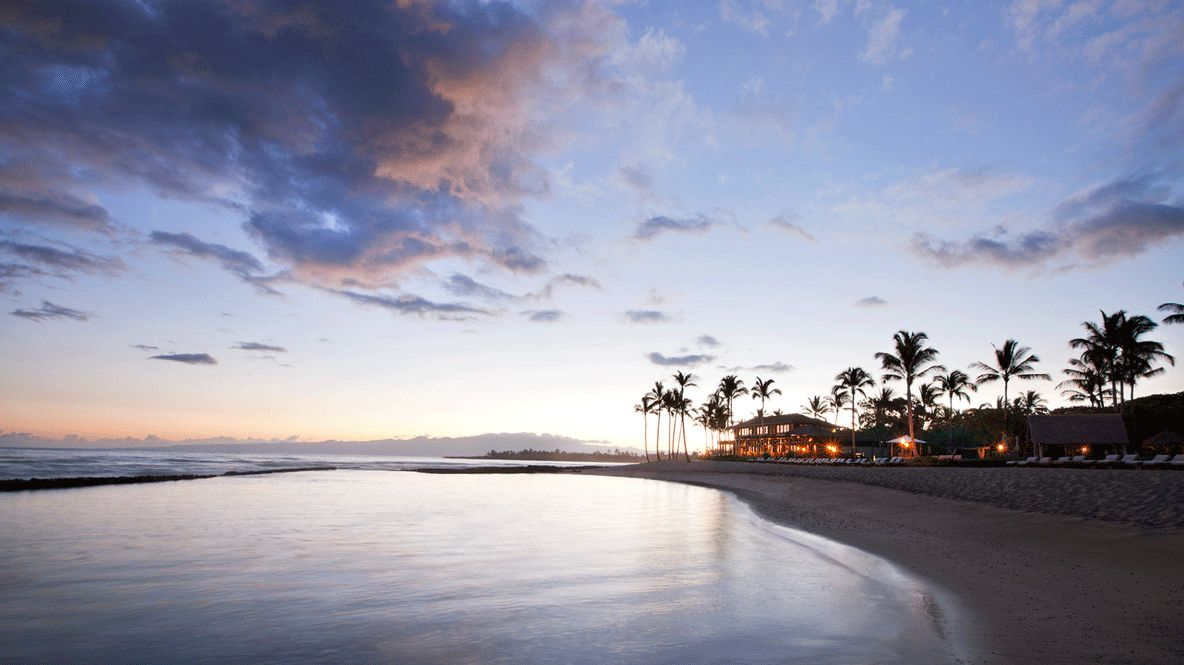hotels in heaven four seasons hualalai beach sunset ocean water cloudy sky blue house sea side lights