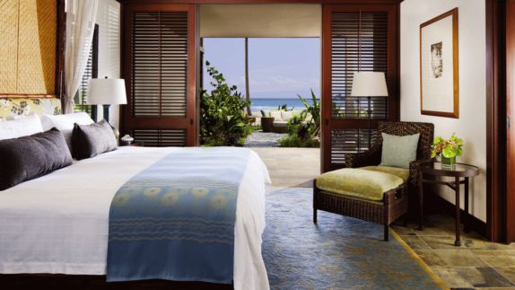 hotels in heaven four seasons hualalai bedroom flower blankets ocean view terrace armchair pillows loungers