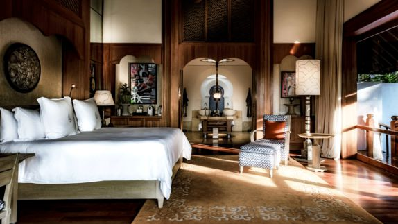 hotels in heaven four seasons langkawi bedroom luxury big bed stack of pillows lamps pictures art rug blanket linen window